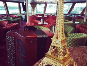 accordion from Paris with eiffel tower during a cruise