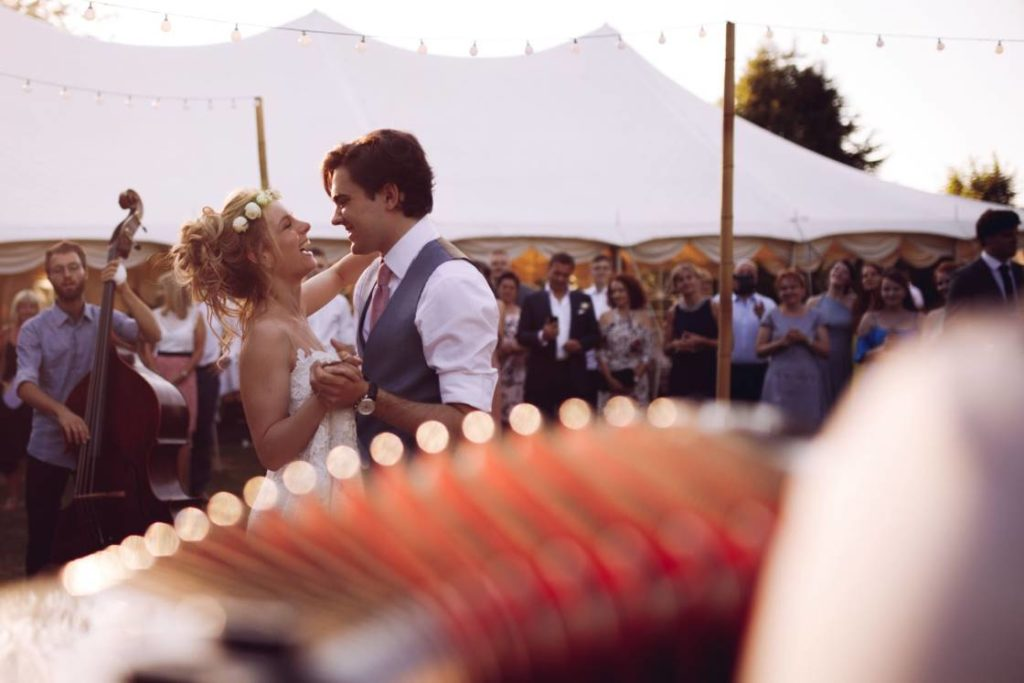 A french accordionist makes the bride and groom dance during the wedding celebration